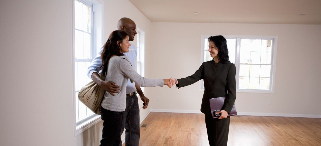 couple buying to rent from property agent